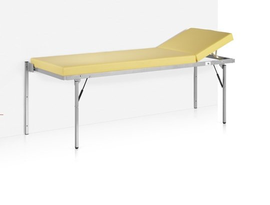 Folding wall-mounted examination tables