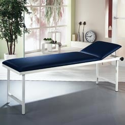 Examination table , adjustable head section